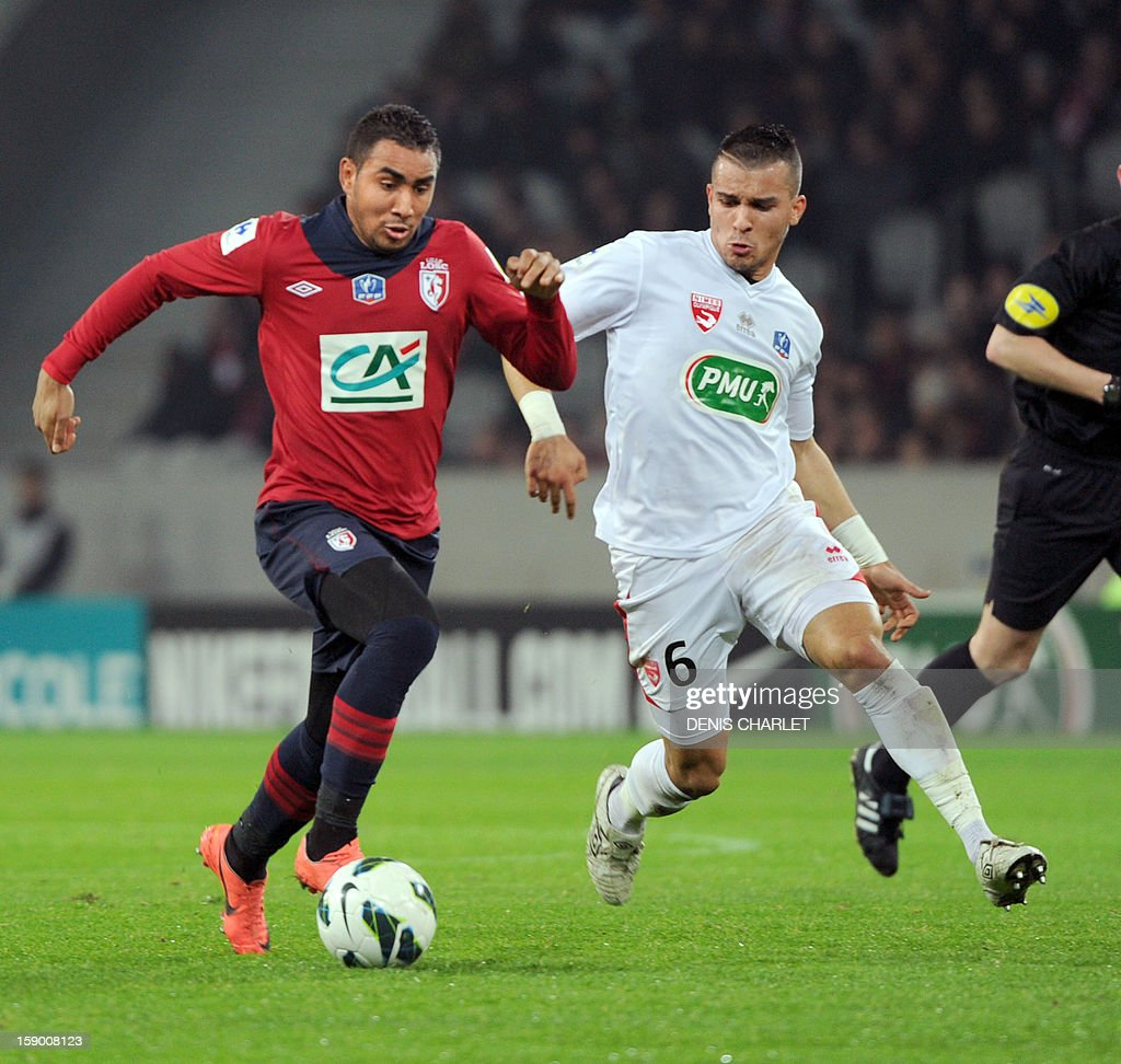 Lille's French forward Dimitri Payet (L) vies with Nimes' defender Yassine Haddou during a French Cup football match between Lille and Nimes at Lille Grand Stade stadium, on January 5, 2013.