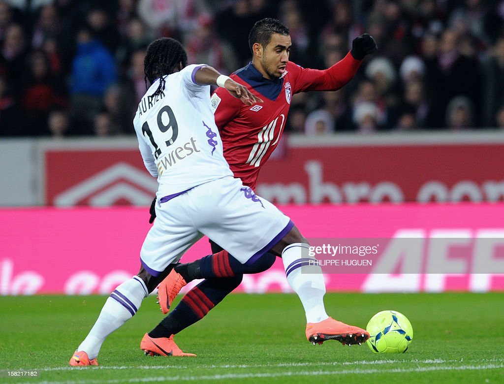 Lille's French forward Dimitri Payet (R) vies with Toulouse's French defender Serge Aurier during the French L1 football match LOSC Lille vs Toulouse FC, on December 11, 2012 at the Lille Grand Stade stadium in Villeneuve d'Ascq.