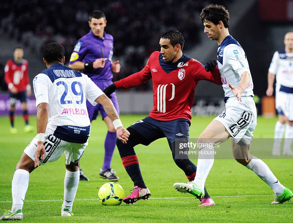 Lille's French forward Dimitri Payet (C) vies with Troyes' French defender Djibril Sidibe (R) and French midfielder Quentin Othon during a French L1 football match between Lille and Troyes on February 2, 2013 at Grand Stade in Villeneuve d'Ascq. AFP PHOTO / PHILIPPE HUGUEN