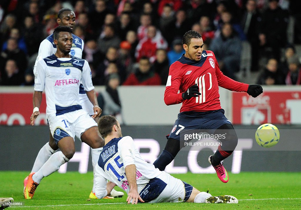 Lille's French forward Dimitri Payet (R) vies with Troyes' French defender Florian Jarjat during the French L1 football match Lille vs Troyes on February 2, 2013 at the Grand Stade Stadium in Villeneuve d'Ascq.