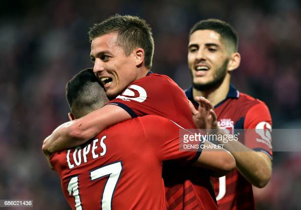 Lille's French forward Nicolas De Preville celebrates with team mates after scoring a goal during the French L1 football match between Lille OSC and...