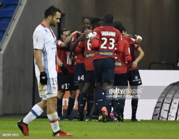 Lille's French forward Nicolas De Preville is congratulated by teamates after scoring a goal during the French L1 football match Olympique Lyonnais...