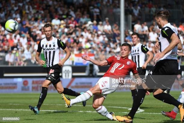 Lille's French forward Nicolas De Preville kicks the ball despite the attention of Angers' French defender Romain Thomas and Angers' French defender...