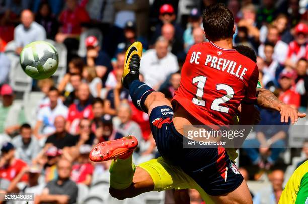 TOPSHOT Lille's French forward Nicolas De Preville kicks the ball during the French Ligue 1 football match between Lille and Nantes on August 6 2017...