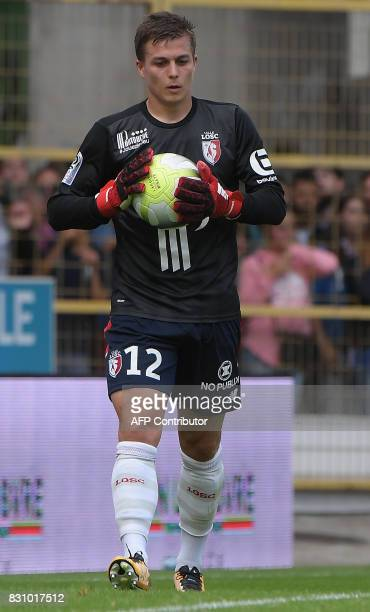 Lille's French forward Nicolas De Preville plays as goalkeeper during the French Ligue 1 football match between Strasbourg and Lille at The Meinau...