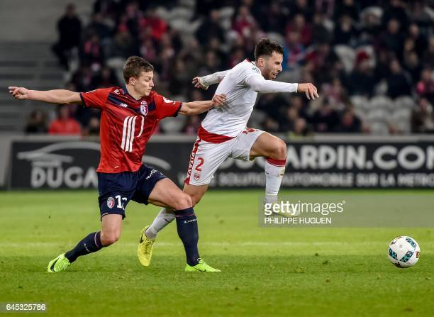 Lille's French forward Nicolas De Preville vies with Bordeaux's defender Milan Gajic during their French L1 football match Lille vs Bordeaux on...