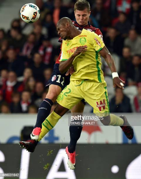 Lille's French forward Nicolas De Preville vies with Nantes' Argentinian forward Emiliano Sala during the French L1 football match between Lille OSC...