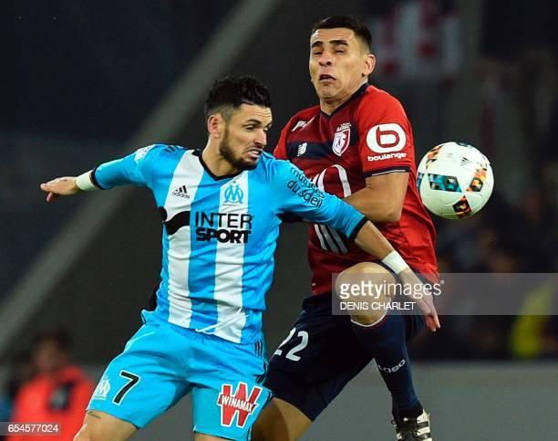 Lille's French forward Nicolas De Preville vies with Olympique de Marseille's French midfielder Remy Cabella during the French L1 football match...