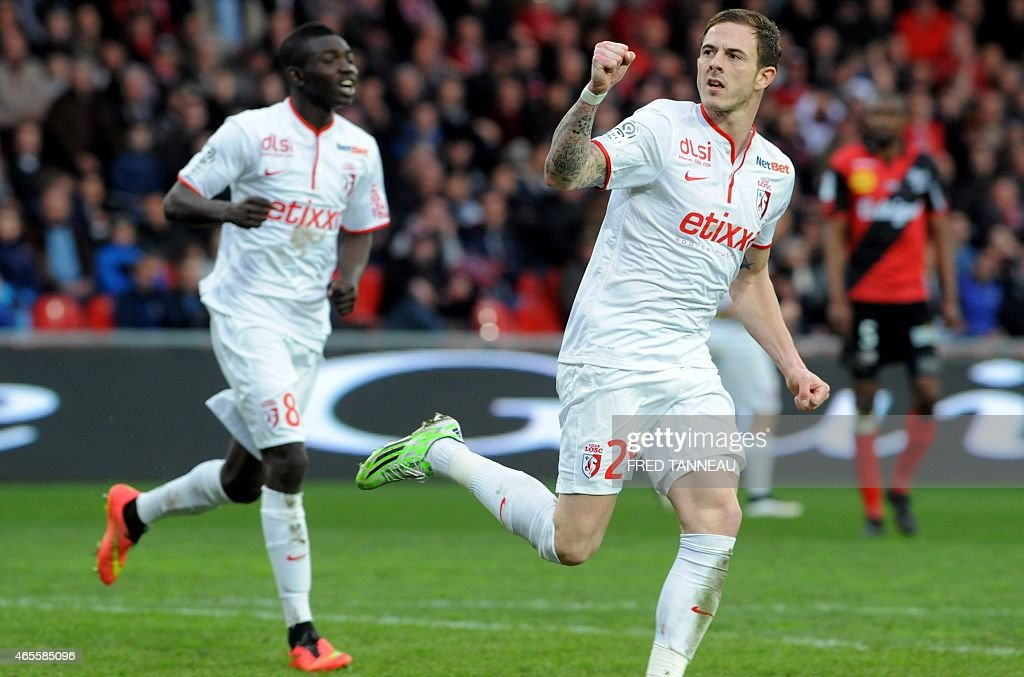 Lille's French forward <a gi-track='captionPersonalityLinkClicked' href=/galleries/search?phrase=Nolan+Roux&family=editorial&specificpeople=5969784 ng-click='$event.stopPropagation()'>Nolan Roux</a> (R) jubilates after scoring during the French L1 football match between Guingamp and Lille on March 8, 2015 at the Roudourou stadium in Guingamp, western of France.