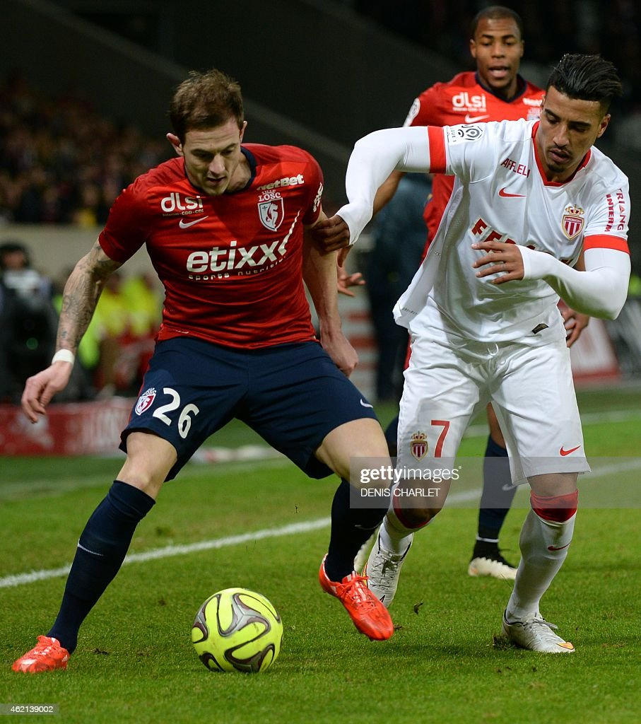 Lille's French forward <a gi-track='captionPersonalityLinkClicked' href=/galleries/search?phrase=Nolan+Roux&family=editorial&specificpeople=5969784 ng-click='$event.stopPropagation()'>Nolan Roux</a> (L) vies for the ball with Monaco's Belgian Moroccan midfielder Nabil Dirar during the French L1 football match between Lille (LOSC) and Monaco (ASM) on January 24, 2015 at the Stade Pierre-Mauroy stadium in Villeneuve-d'Ascq, northern France.
