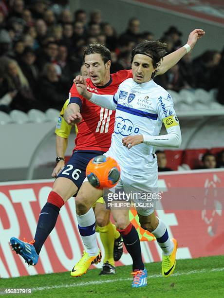 Lille's French forward Nolan Roux vies with Bastia's Algerian defender Fethi Harek during the French L1 football match Lille vs Bastia on December 15...