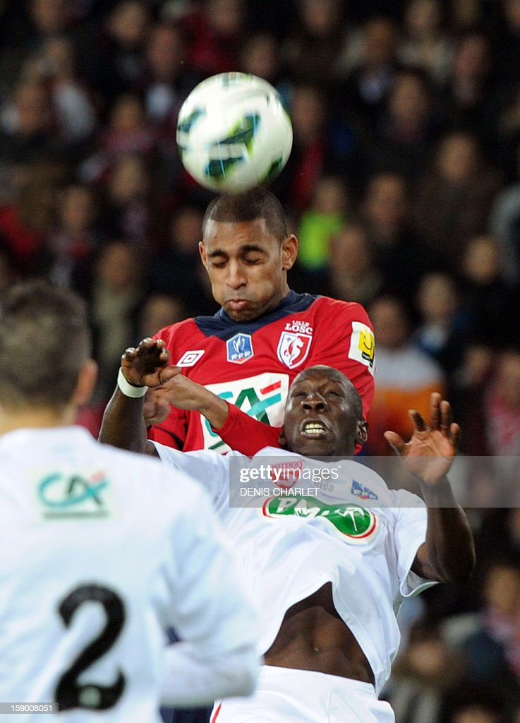 Lille's French forward Ronny Rodelin (R) vies with Nimes's forward Seydou Kone during their French Cup football match between Lille and Nimes at the Grand Stade , on January 5, 2013, in Lille .
