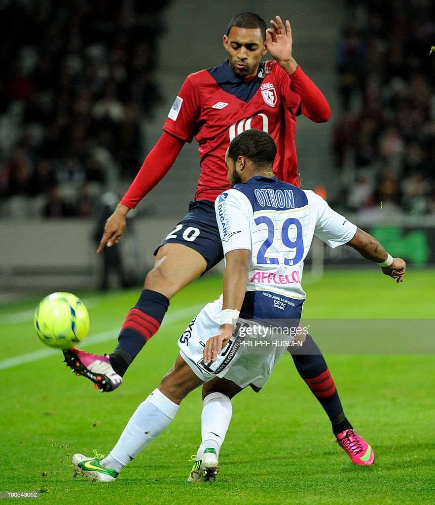 Lille's French forward Ronny Rodelin (L) vies with Troyes' French midfielder Quentin Othon during a French L1 football match between Lille and Troyes on February 2, 2013 at Grand Stade in Villeneuve d'Ascq.