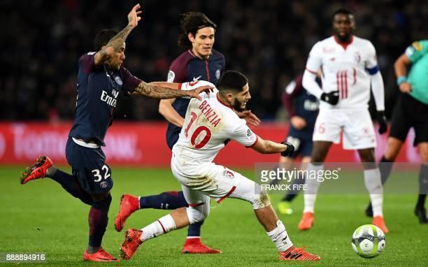 Lille's French forward Yassine Benzia outruns Paris SaintGermain's Brazilian defender Dani Alves during the French L1 football match between Paris...