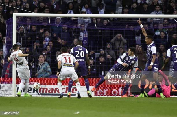 Lille's French forward Yassine Benzia scores a goal during the French L1 football match between Toulouse against Lille on March 5 at the Municipal...