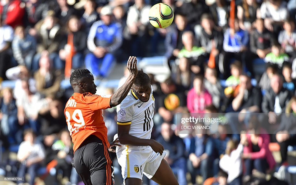 Lille's French forward Yassine Benzia (R) vies with Lorient's French defender Pape Abdou Paye during the French L1 football match Lorient vs Lyon at the Moustoir stadium in Lorient, western France, on April 30, 2016.