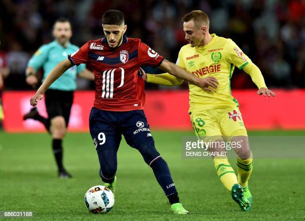 Lille's French forward Yassine Benzia vies with Nantes' French midfielder Valentin Rongier during the French L1 football match between Lille OSC and...