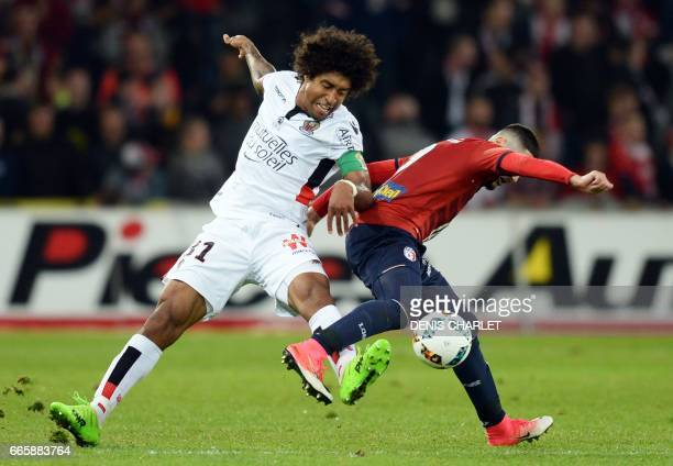 Lille's French forward Yassine Benzia vies with Nice's Tunisian forward Bassem Srarfi during the French L1 football match between Lille and Nice at...