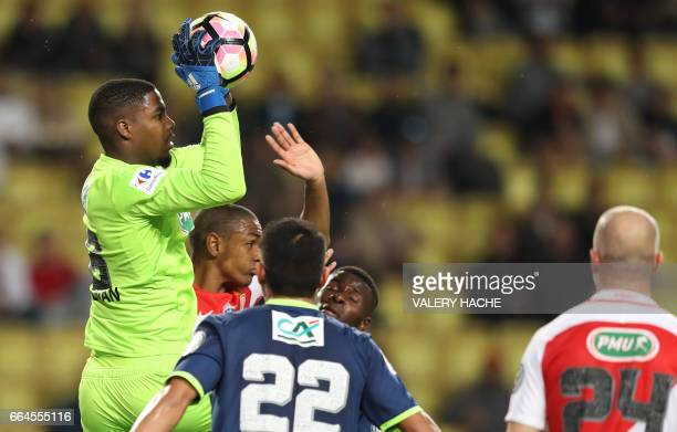 Lille's French goalkeeper Mike Maignan stops a ball during the French Cup football match between Monaco vs Lille at the 'Louis II' stadium in Monaco...