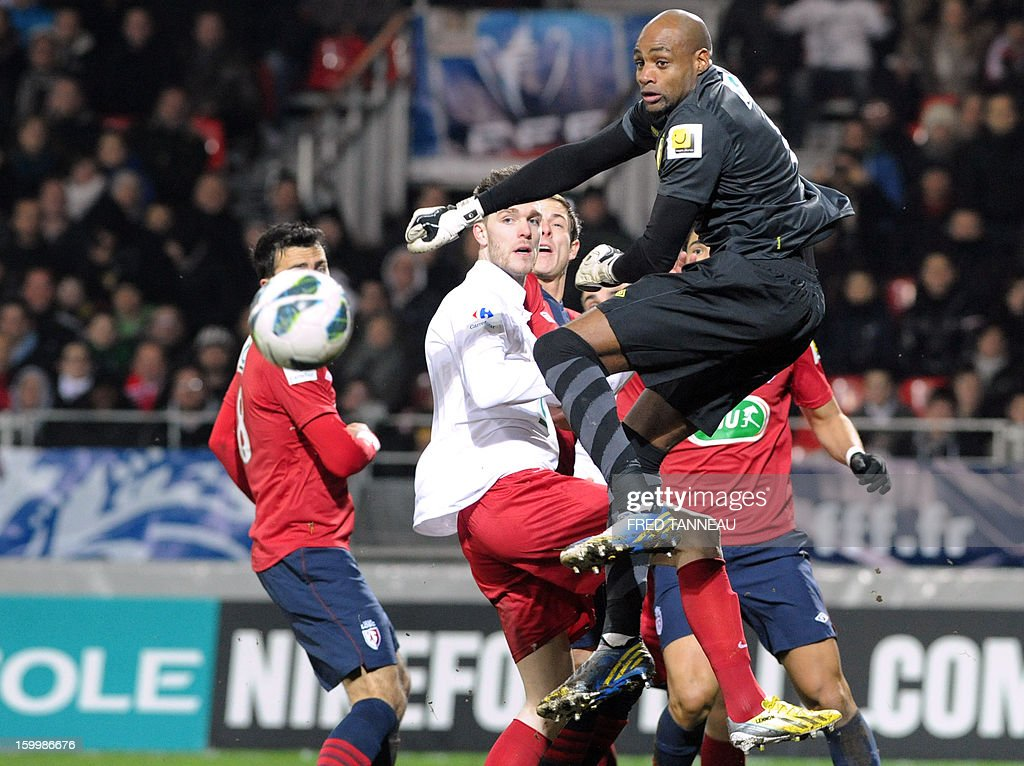 Lille's French goalkeeper Steeve Elana (R) clears a shoot during the French Cup football match Plabennec vs Lille on January 24, 2013 in Brest, western of France.