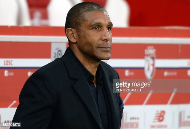 Lille's French head coach Franck Passi looks on during the French L1 football match between Lille and Nice at the PierreMauroy Stadium in Villeneuve...