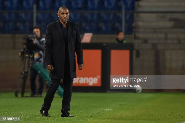 Lille's French head coach Franck Passi looks on during the French L1 football match Montpellier vs Lille at the Mosson stadium in Montpellier on...