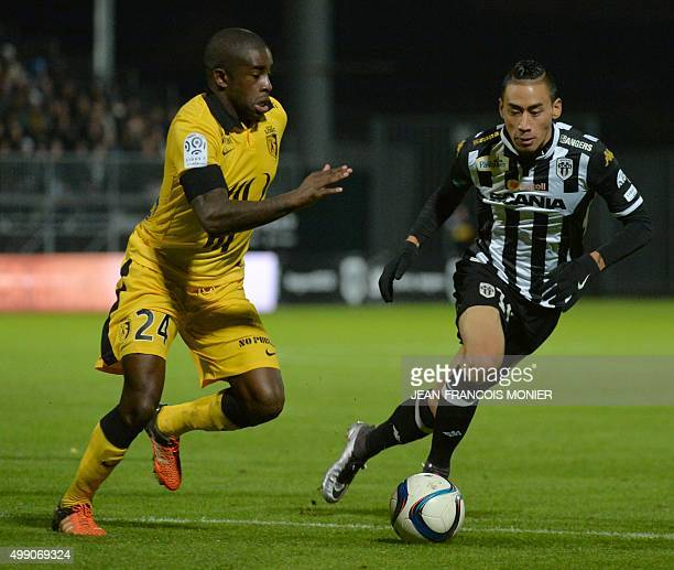 Lille's French midfielder Antonio Mavuba vies with Angers' French forward Billy Ketkeophomphon during the French L1 football match between Angers and...