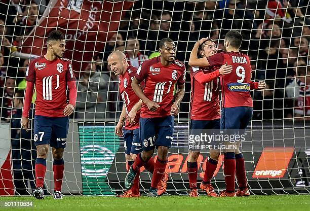 Lille's French midfielder Eric Bautheac celebrates with teammates after scoring a goal during the French L1 football match between Lille OSC and FC...