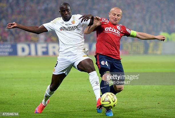 Lille's French midfielder Florent Balmont vies for the ball with Lens' French forward Adamo Coulibaly during the French L1 football match between...