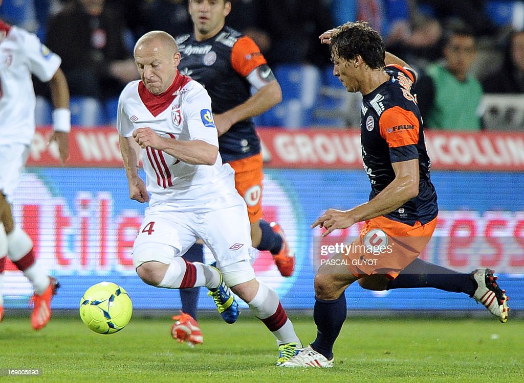 Lille's French midfielder Florent Balmont (L) vies with Montpellier's French defender Benjamin Stambouli (R) during the French L1 football match Montpellier vs Lille on May 18, 2013 at the Mosson stadium in Montpellier, southern France. AFP PHOTO / PASCAL GUYOT