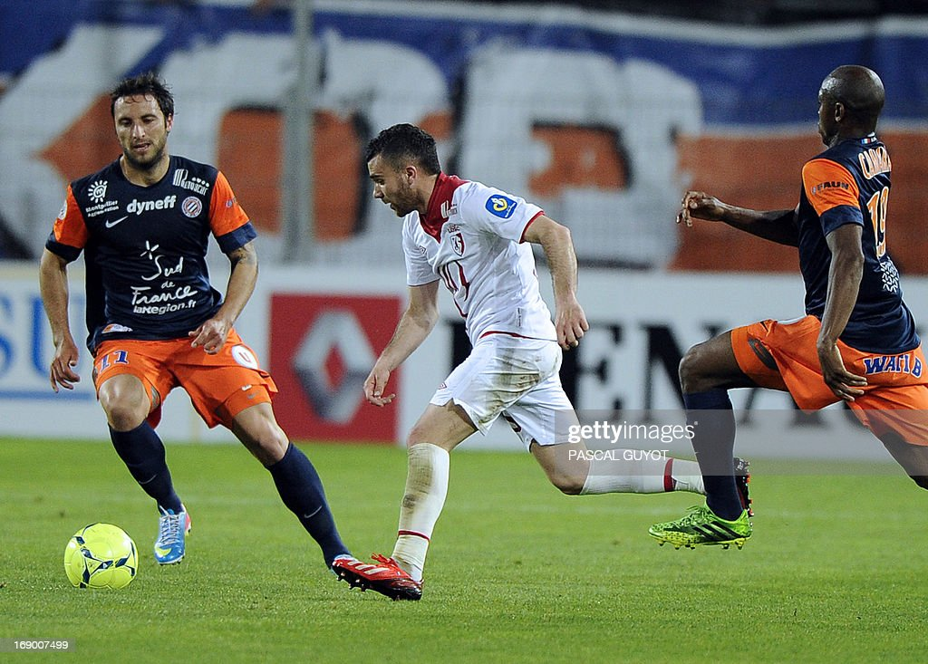 Lille's French midfielder Marvin Martin (C) vies with Montpellier's Argentinian forward Emmanuel Herrera (L) and Montpellier's Senegalese forward Souleymane Camara (R) during the French L1 football match Montpellier vs Lille on May 18, 2013 at the Mosson stadium in Montpellier, southern France.