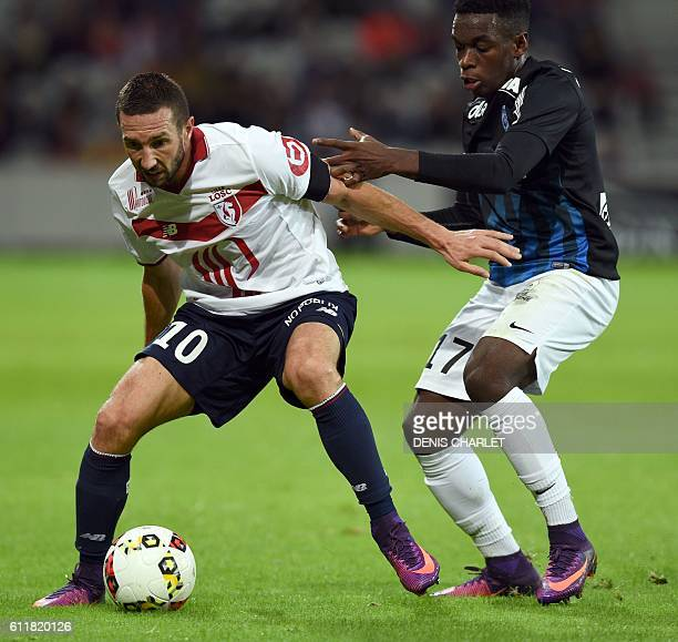 Lille's French midfielder Morgan Amalfitano vies with Nancy's French defender Faitout Maouassa during the French L1 football match between Lille and...