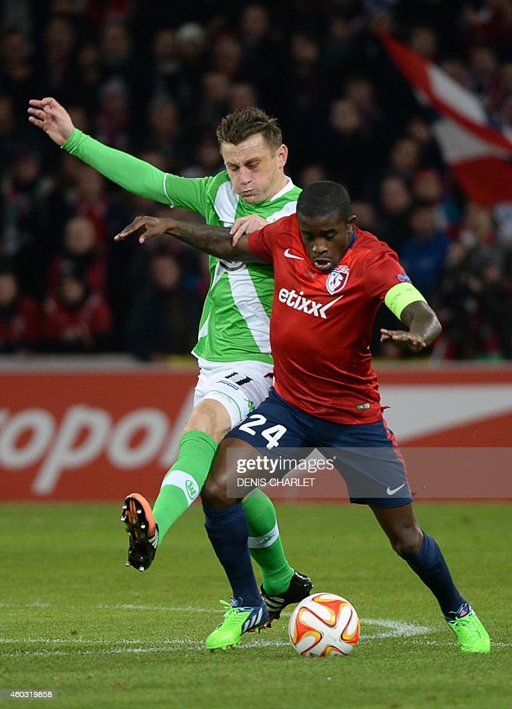 Lille's French midfielder <a gi-track='captionPersonalityLinkClicked' href=/galleries/search?phrase=Rio+Mavuba&family=editorial&specificpeople=708351 ng-click='$event.stopPropagation()'>Rio Mavuba</a> (R) vies with Wolsburg's Croatian forward <a gi-track='captionPersonalityLinkClicked' href=/galleries/search?phrase=Ivica+Olic&family=editorial&specificpeople=547277 ng-click='$event.stopPropagation()'>Ivica Olic</a> during the UEFA Europa League group H football match between Lille (LOSC) and VfL Wolfsburg on December 11, 2014 at the Pierre-Mauroy stadium in Villeneuve-d'Ascq, northern France.