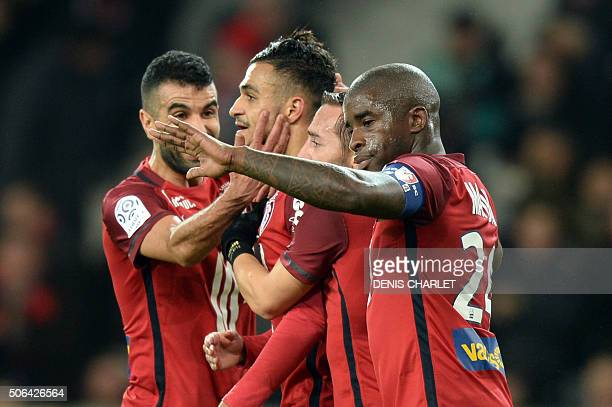 Lille's French midfielder Sofiane Boufal is congratulated by teammates after scoring a goal during the French L1 football match Lille and Troyes on...