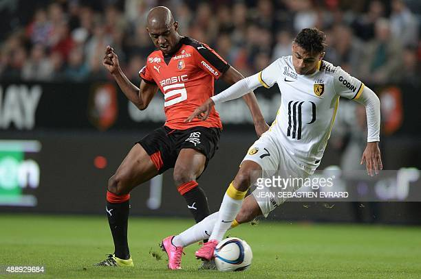 Lille's French midfielder Sofiane Boufal vies with Rennes' Cape Verdean midfielder Gelson Fernandes during the French L1 football match between...