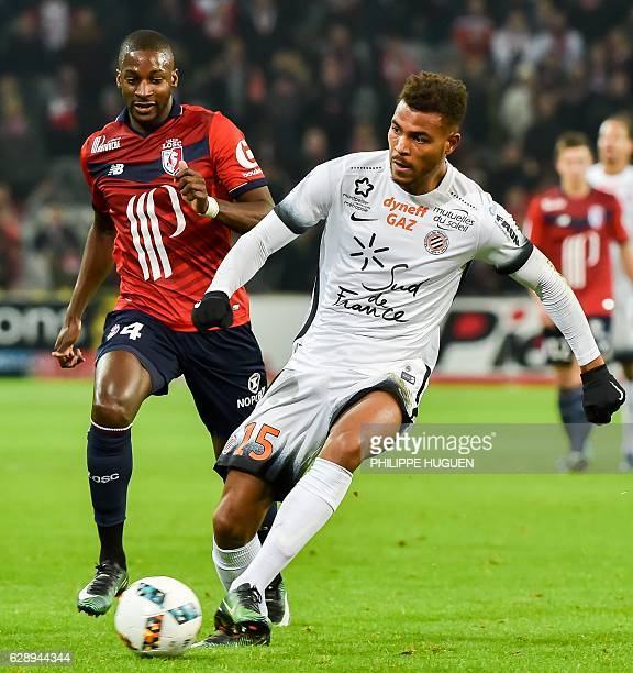 Lille's French midfielder Younousse Sankhare vies with Montpellier's French forward Steve Mounie during the French L1 football match Lille vs...