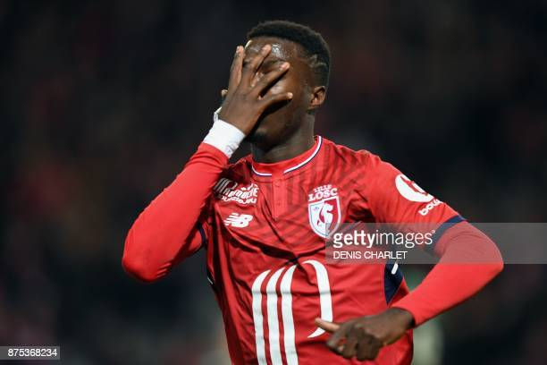 Lille's FrenchIvorian forward Nicolas Pepe celebrates after scoring a goal during the French L1 football match between Lille and Saint Etienne at the...