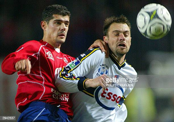 Lille's Greek defender Efstathios Tavlaridis fights for the ball with Sochaux French forward Serge Pagis during their French L1 soccer match 07...