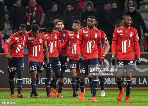 Lille's Ivorian forward Nicolas Pepe celebrates with teammates after scoring a goal during the French L1 football match between Lille and Toulouse on...