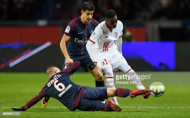 Lille's Ivorian forward Nicolas Pepe under pressure from Paris SaintGermain's Spanish defender Yuri Berchiche is tackled by Paris SaintGermain's...