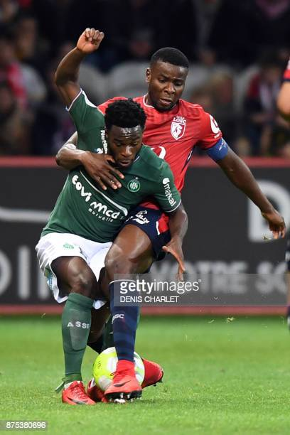 Lille's Ivorian forward Nicolas Pepe vies for the ball with SaintEtienne's French forward Jonathan Bamba during the French L1 football match between...