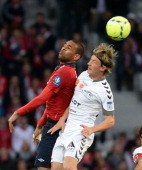 Lille's Ivorian forward Salomon Kalou vies with Reims' French midfielder Johan Ramare during the French L1 football match Lille vs Reims on May 10...