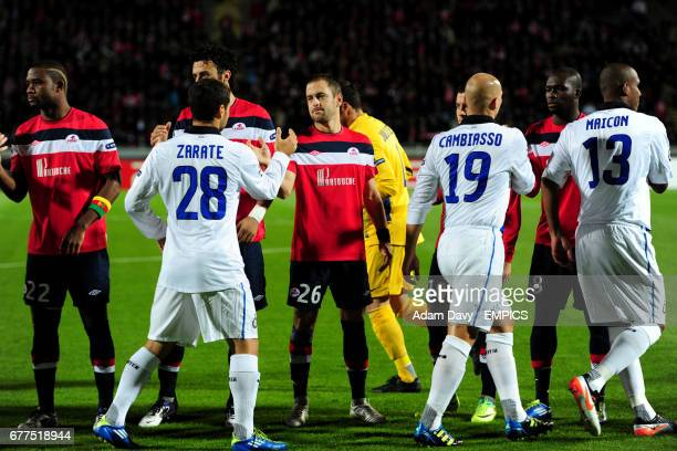 Lille's Joe Cole greets Inter Milan's Mauro Zarate before the match