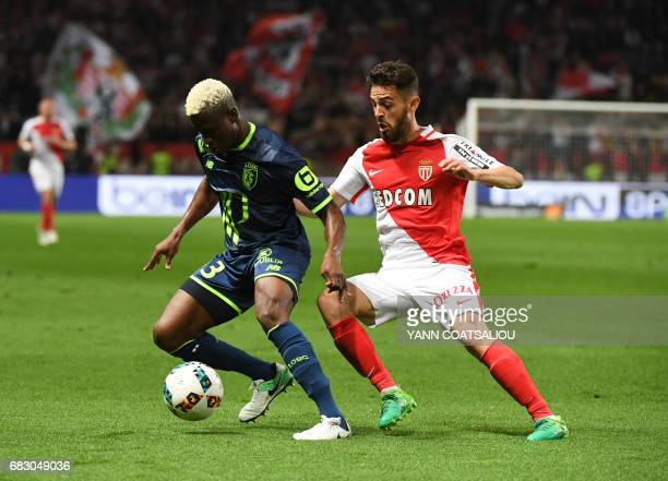 Lille's Malian defender Youssouf Kone vies with Monaco's Portuguese midfielder Bernardo Silva during the French L1 football match between Monaco and...