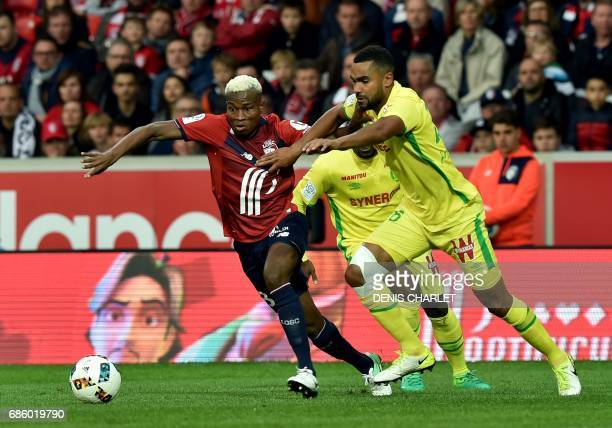 Lille's Malian defender Youssouf Kone vies with Nantes' French defender Levy Djidji during the French L1 football match between Lille OSC and Nantes...