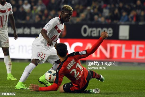 Lille's Malian midfielder Yves Bissouma vies with Rennes' French midfielder Benjamin Andre during the French L1 football match between Rennes and...