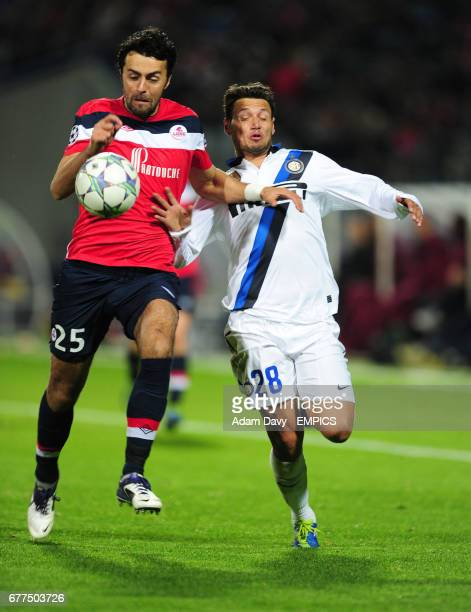 Lille's Marko Basa and Inter Milan's Mauro Zarate battle for the ball