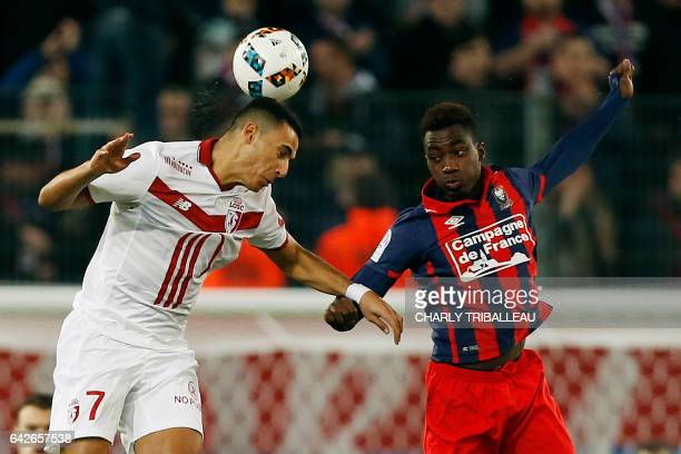 Lille's Maroccan Dutch midfielder Anwar El Ghazi heads the ball as he vies with Caen's French forward Yann Karamoh during the French L1 football...