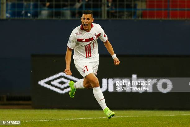 Lille's midfielder Anwar El Ghazi celebrates after scoring a goal during the French L1 football match between Caen and Lille on February 18 2017 at...