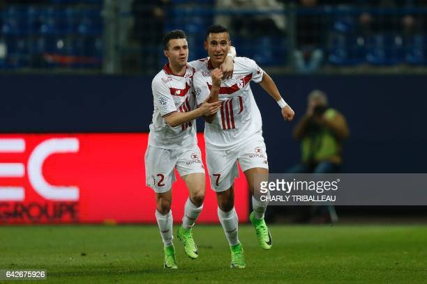 Lille's midfielder Anwar El Ghazi celebrates with Lille's defender Sebastien Corchia after scoring a goal during the French L1 football match between...